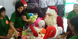 Compassionated volunteers with Santa Clause