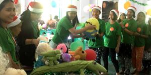 "Giving stuffs to children for ""one stuffed animal toy per orphaned child"" program on Christmas"